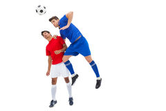 Football players tackling for the ball. On white background Stock Image