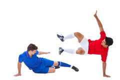 Football players tackling for the ball. On white background Stock Images