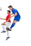Football players tackling for the ball. On white background Stock Photo