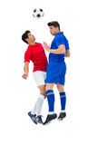 Football players tackling for the ball. On white background Royalty Free Stock Photography