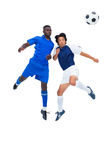 Football players tackling for the ball. On white background Royalty Free Stock Images