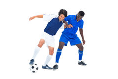 Football players tackling for the ball Royalty Free Stock Images