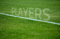 Football Players text on grass with white lane Stock Photography