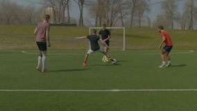 Football players training on soccer field in spring stock video footage