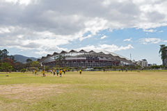 Football Playing children in front of the national stadium in San Jose Costa Rica stock photos