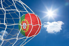 Football in portugal colours at back of net Royalty Free Stock Photography
