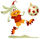 Football Rabbit. Vector illustration of rabbit, the symbol of  2011, kicking the bauble-shaped football Stock Image