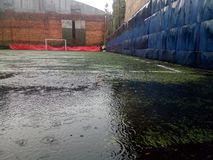 Football in the rain royalty free stock photo