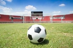 Football ready to kick into the goal in Stadium Stock Image