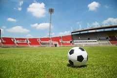 Football ready to kick into the goal in Stadium Stock Images