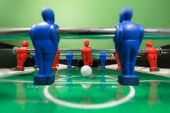 Football with red and blue players. Table football with red and blue players Royalty Free Stock Photography