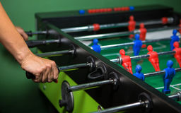 Football with red and blue players. Table football with red and blue players Stock Photos