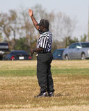 Football Referee. Making a call for Peewee football game Stock Image