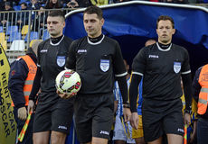 Football referee brigade enter the pitch Stock Photography