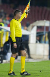 Football referee performs during the soccer game Stock Image