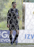 Football referee seen through net Stock Image