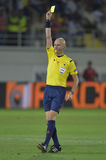 Football referee, Sergei Karasev shows yellow card Royalty Free Stock Photos