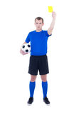 Football referee showing yellow card Royalty Free Stock Photos