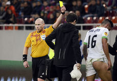 Football referee shows yellow card Stock Photo