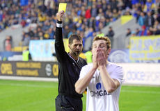 Football referee shows yellow card Stock Photography