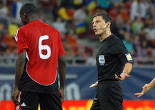 Football Referee talks to player Royalty Free Stock Photography