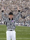 Football Referee Touchdown. A football official signals touchdown at a football game Stock Image
