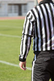Football referee. Watch football referee in the game Stock Photo