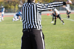 Football referee. Watch football referee in the game Royalty Free Stock Photo