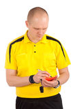Football referee writing on red card Stock Photos