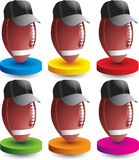 Football referees on colored discs Stock Photo