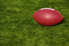 Football Resting on Artificial Turf Stock Photo