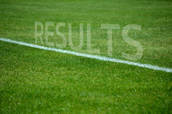 Football Results text on grass with white lane Stock Images