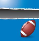 Football on ripped blue banner Stock Photo