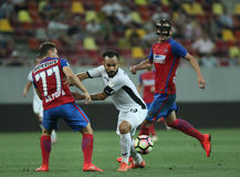 Football Romania's Liga 1– Steaua Bucuresti vs. Astra Giurgiu. Steaua Bucharest's Adrian Popa ( L ) and Bojan Golubovic ( R ) vies for the ball with Astra Royalty Free Stock Photography