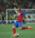Football Romania's Liga 1– Steaua Bucuresti vs. Astra Giurgiu. Steaua Bucharest's Bogdan Mitrea in action during a soccer match Steaua Bucharest vs. Astra Stock Photo