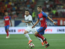 Football Romania's Liga 1– Steaua Bucuresti vs. Astra Giurgiu. Steaua Bucharest's Florin Tanase ( R ) vies for the ball with Astra Giurgiu's Alexandru Ionita Stock Photography