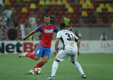Football Romania's Liga 1– Steaua Bucuresti vs. Astra Giurgiu. Steaua Bucharest's Gabriel Tamas ( L ) in action during a soccer match Steaua Bucharest vs Stock Photos