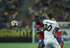Football Romania's Liga 1– Steaua Bucuresti vs. Astra Giurgiu. Steaua Bucharest's Wilfred Moke ( L ) vies for the ball with Astra Giurgiu's Florin Lovin ( R Stock Photos