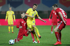 FOOTBALL - ROMANIA vs. LITHUANIA. Romania's Mihai Pintilii ( CR ) and Lithuania's Mantas Kuklys ( CL ) in action during a friendly match Romania vs. Lithuania Stock Photo