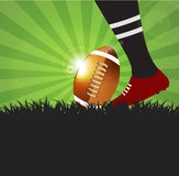 Football or rugby player with ball on grass  background Stock Image