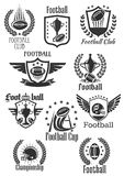 Football rugby vector symbols for championship cup. Rugby football club icons set for tournament or championship cup. Badges of fire rugby ball with wings and Stock Photos