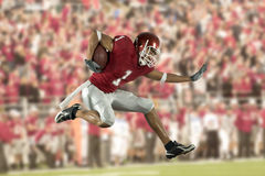 Football Runner with Crowd Stock Photography