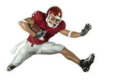 Football Runner with Crowd. American football player in action with ball Stock Photos