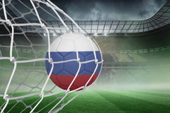 Football in russia colours at back of net Stock Photography