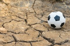 Football on sand ground. With suset background, classic ground concept, playing funny sport Stock Image