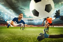 Football scene with competing football players at the stadium. 3D Rendering stock images