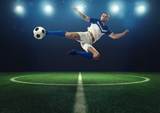 Soccer striker hits the ball with an acrobatic kick stock photos