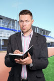 Football scout at work Royalty Free Stock Images