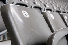 Football seat. Number one in a row of football soccer stadium seats Royalty Free Stock Photography