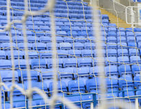 Football seating behind goal. The seating of a football stadium behind a goal Royalty Free Stock Photos